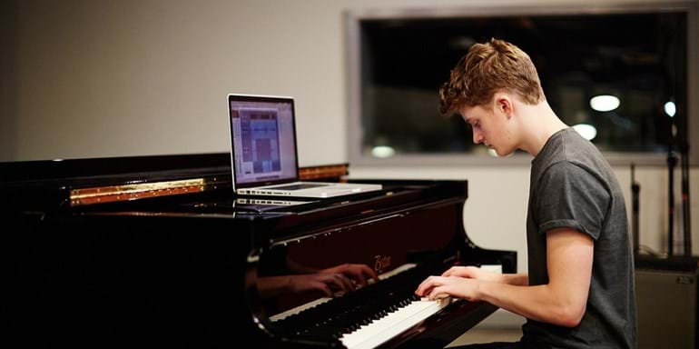 Student playing Steinway piano