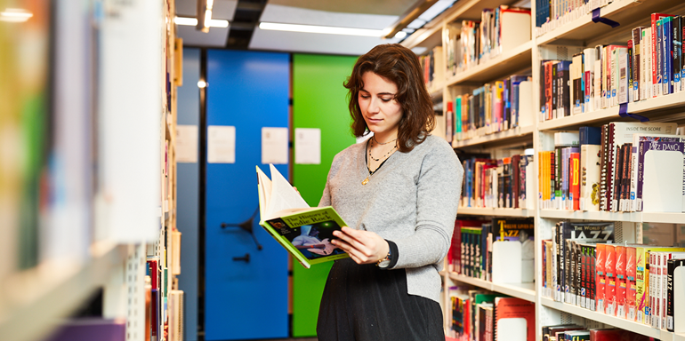 Library Female Student With Books
