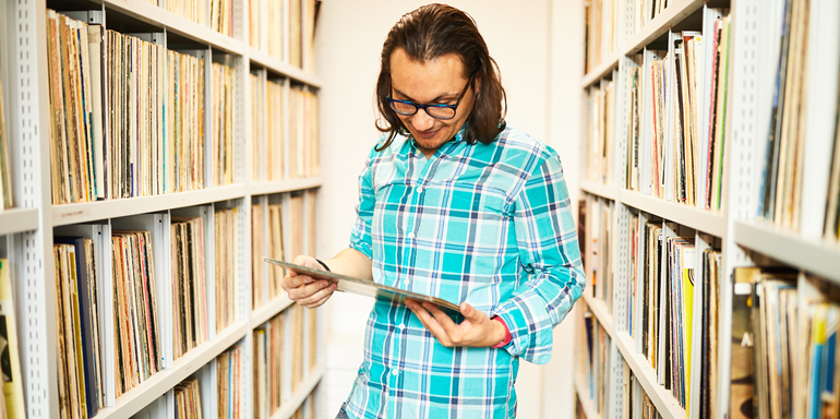 Library Male Student With Vinyl Albums